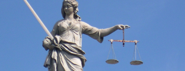 Lady Justice balancing the scales